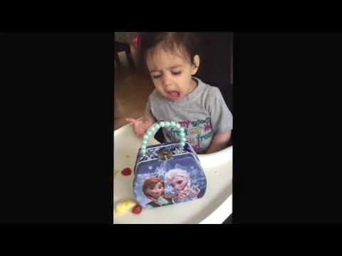 baby gets too excited about her frozen lunch box