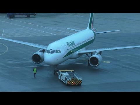 Alitalia Airbus A320 Push back at London Heathrow Airport, Terminal 4