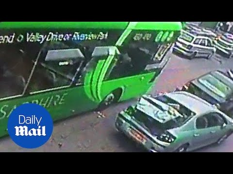 Out of control bus causes cars to collide on main road - Daily Mail