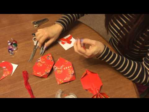 How to make a goldfish for Chinese New Year out of red packets. Part 2 of 2