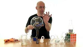 A mirror paradox, Klein bottles and Rubik