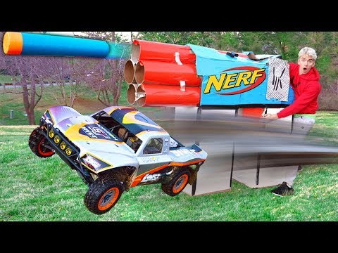 WORLDS BIGGEST CARDBOARD NERF GUN VS RC CAR!!