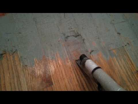 Using floor stripper on painted wood floors removing a couple layers of old latex floor paint