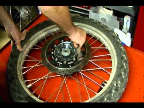 Motorcycle Repair: Removing & Installing a Motorcyce Front Brake Disc on a 2009 Kawasaki KLR 650