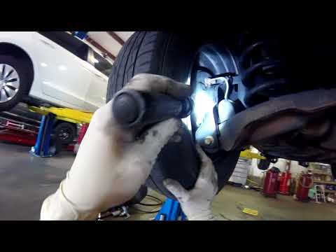 04-11 Ford Focus E brake/rear brake adjustment