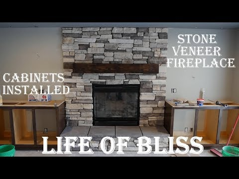 Installed Stacked Stone Fireplace | Stained Built In Cabinets | Basement Build 18