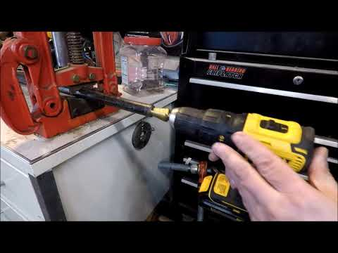Reaming black iron pipe with step drill bit