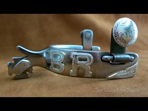 Metal Working: Handmade cowboy spurs steel with hard soldered silver mountings