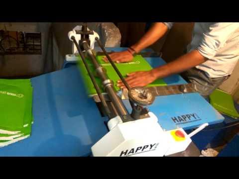 PAPER BAG CREASING MACHINE / PAPER CARRY BAG CREASING MACHINE