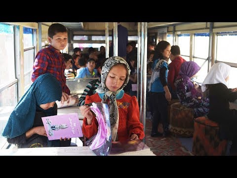 Library on wheels: Kabul's first library bus drives Afghan children to read
