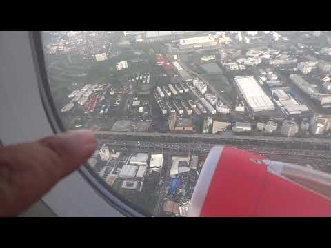 inside a Thai air asia plane taking off from DMK airport