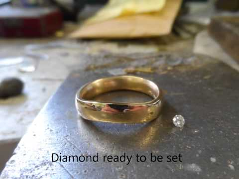 Melting gold to hand make a gold diamond ring