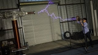 Download How Giant Tesla Coils Work (with ArcAttack) Video