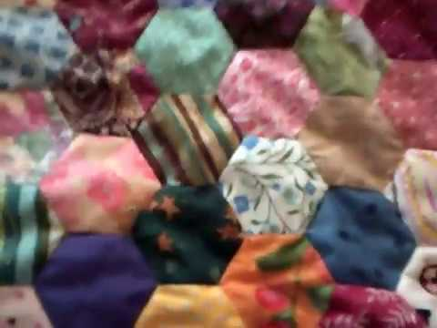 Scrappy fabric hexagon quilt hand sewn