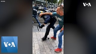 Police Officer Punched to Ground After Bastille Day Parade in France