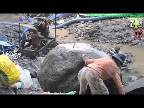 Old Man Breaking The Big Rocks By Hand Chisels