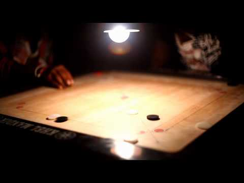 Boys playing carrom on Agatti Island - Lakshadweep