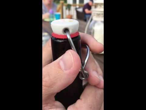 Slow motion flip top bottle opening