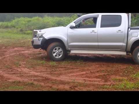 Hilux doing mud donuts in Fiji