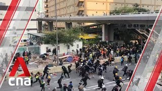 Hong Kong police charge towards protesters in Kowloon Bay