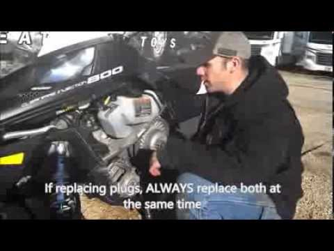 How to change the spark plugs in a snowmobile