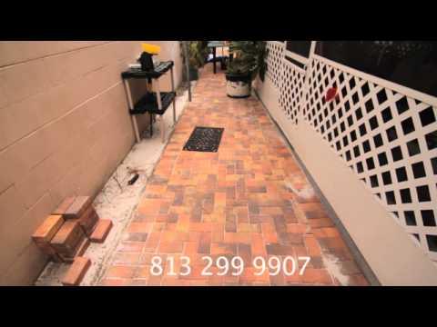 Brick pavers and travertine paver on driveway, patio, pool deck and walkway