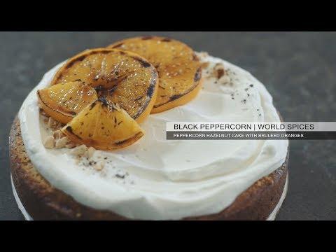 Black Peppercorn - Peppercorn Hazelnut Cake with Whipped Orange Honey Cream and Bruleed Oranges