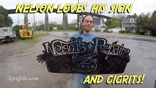 nelsons sign and the frigsaker moble