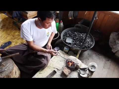Traditional Burmese silver smith working at floating workshop on Inle Lake