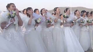 Chinese navy holds group wedding for soldiers, officers in east China