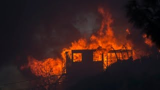 Firefighters battle heavy winds as fires burn in southern California
