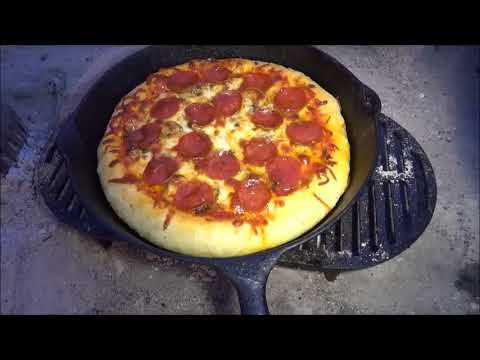 Cast Iron Skillet Pizza Cooked with Charcoal Outdoors PREVEIW
