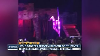 Pole dancers perform in front of students