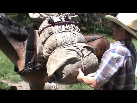 Packing a basket hitch on a pack saddle