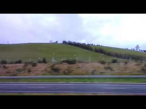 Travelling by bus through the countyside in Ireland from Belfast to Dublin