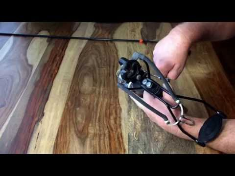 Slingbow with fishing reel