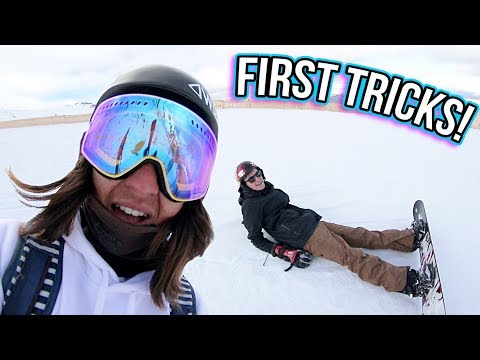 LEARNING HIS FIRST SNOWBOARD TRICKS!