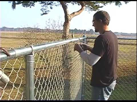 Self-Locking Bands dress up small chain link fence job