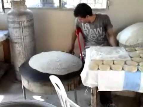 making lebanese bread in Jdaidet, Marjeyoun - south Lebanon.wmv خبز الصاج
