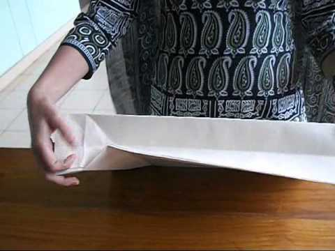 How to make a simple Paper carry-bag (explained in Malayalam)
