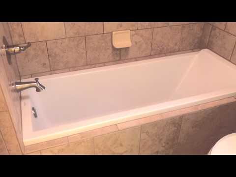 Beautiful European drop-in tub with Italian tile surround
