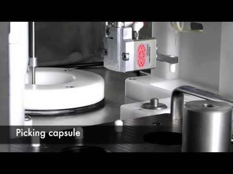 AseptiBot dispensing I-131 solution into gel capsules