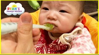 Baby First Time Eating Baby Food gross yucky Face! Twin Babies first solid food! Ryan