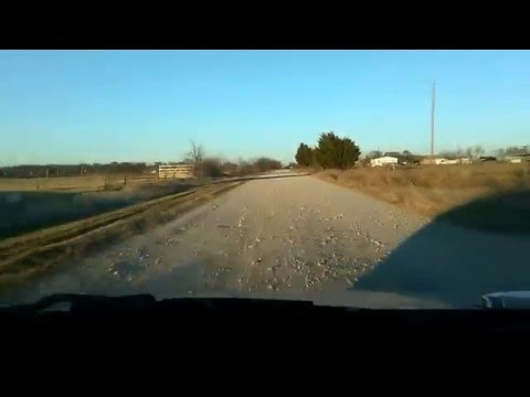 Driving fast and taking chances. On a country road in Texas
