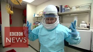 Ebola: How doctors protect themselves from the virus - BBC News
