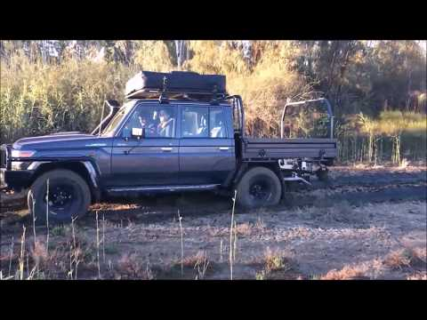 V8 Turbo Diesel 79 LandCruiser on 35's stuck in the mud