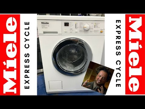 Miele W3240 washing machine going through express wash cycle with load inside