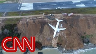 Plane skids off runway, gets stuck on cliff