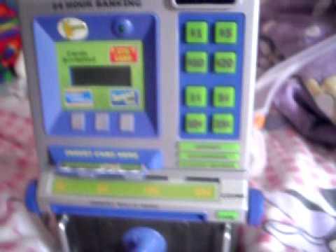 Me robbing my fake at home play bank :P