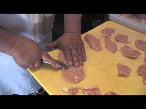 Thin cutting chicken breast.
